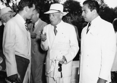 Leonard Bernstein, Serge Koussevitzky, and Eleazar de Carvalho conversing together at Tanglewood, 1947. Photograph by Heinz Weissenstein/ Whitestone Photo