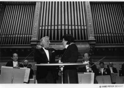 Leonard Bernstein and Seiji Ozawa during the curtain call for the world premiere of Bernstein's Divertimento, September 25, 1980. Photograph by Peter Schaaf