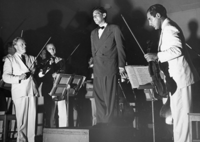 Bernstein, center, stands after a performance in the Shed with Richard Burgin, Alfred Krips, and Joseph de Pasquale (L to R), circa 1949. Photograph by Howard Babbitt