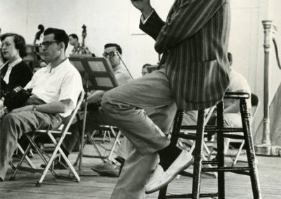"Leonard Bernstein working with TMC students, circa 1955. Photograph by Constantine ""Gus"" Manos"
