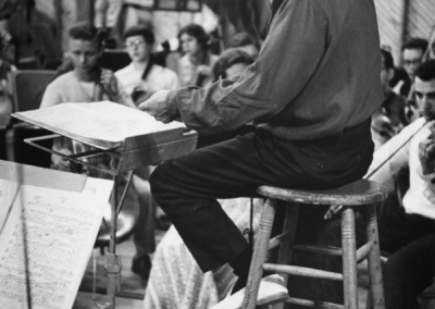 "Leonard Bernstein conducting a TMC orchestra rehearsal, circa 1955. Photograph by Constantine ""Gus"" Manos"
