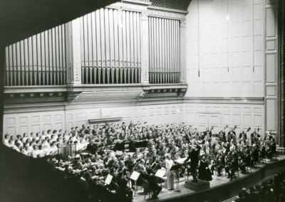 Charles Munch conducting the BSO American premiere of Bernstein's Kaddish Symphony at Symphony Hall with Felicia Montealegre Bernstein (speaker, standing in white) and Jennie Tourel (soprano, seated), January 31, 1964