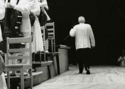 Leonard Bernstein walks off stage after his last concert, August 19, 1990. Photographed by Walter H. Scott
