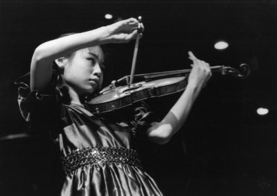 Midori performs Bernstein's Serenade, July 26, 1986. Photograph by Walter H. Scott